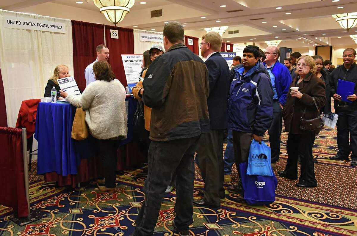 A long line of job seekers stand in line to talk to representatives at the United States Postal Service booth during the Times Union Job Fair at the Albany Marriott hotel on Monday Jan. 16, 2017 in Colonie, N.Y. (Lori Van Buren / Times Union)