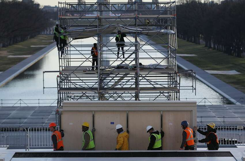 WASHINGTON, DC - JANUARY 13: Workers prepare the stage in front of the Lincoln Memorial to be used in the presidential inauguration festivities for President elect Donald Trump as he prepares to take the reins of power next week on January 13, 2017 in Washington, DC. The inauguration will take place on January 20th when President Barack Obama ends his 8 year run as Americas president. (Photo by Joe Raedle/Getty Images)