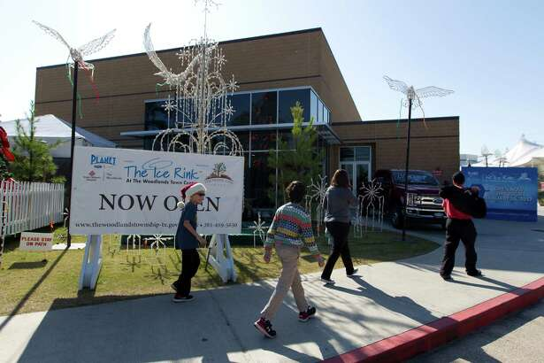 Visitors walk toward The Ice Rink at The Woodlands Town Center in its new location at The Cynthia Woods Mitchell Pavilion Thursday, Dec. 22, 2016, in The Woodlands. The new ice rink facility, which was previously housed for the past 15 years in a tent assembled on the corner of Lake Robbins Drive and Six Pines Drive, was a joint project between The Woodlands Township and the Pavilion. The two entities split the $5.5 million cost to build the 21,000-square-foot building on the Pavilion's property, off of Lake Robbins Drive, and share use of it. The Pavilion uses it as the House of Blues during the summer, while the township transforms it into an ice rink in the winter.