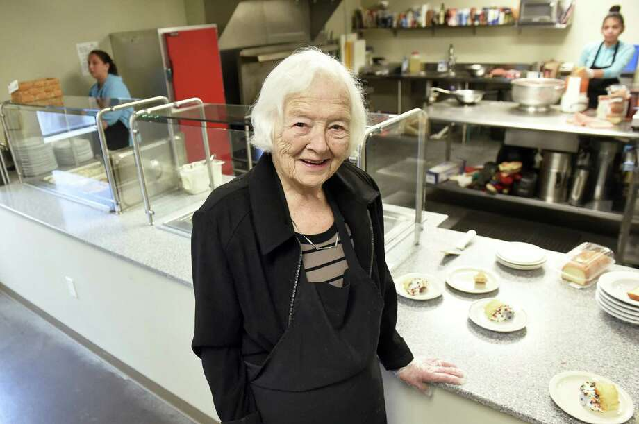 Mary Jane Smith helps serve lunch on Wednesday, Feb. 3, 2016, at Unity House in Troy. Smith was one of the founders of Unity House. (Times Union) ORG XMIT: MER2016020315324603 Photo: Cindy Schultz / Albany Times Union