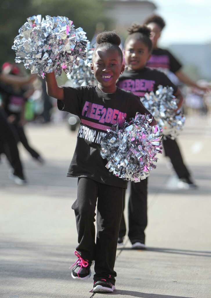 Cheerleaders march along route The 23rd Annual MLK Grande Parade Monday, Jan. 16, 2017, in Houston. The parade consists of 15 Parade floats and 30 Marching bands.