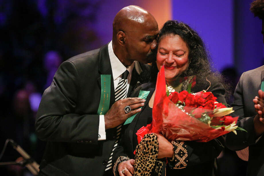 Chairperson Myrna Irons is congratulated by her husband Gerald Irons, Sr. after receiving a special recognition during the 29th annual Dr. Martin Luther King, Jr. Commemorative Celebration on Monday, Jan. 16, 2017, at The Woodlands United Methodist Church. Photo: Michael Minasi, Staff Photographer / © 2017 Houston Chronicle