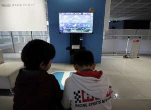 Children play Nintendo Co.'s Super Mario Maker video game using the company's Wii U game console controllers at the Nintendo Game Front showroom in Tokyo, Japan, in December. Parents struggle with enabling excessive video gaming in their children.