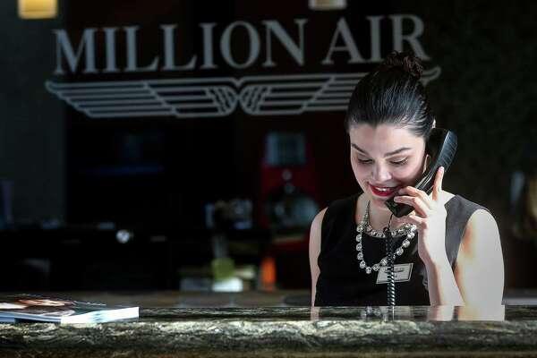 Miriam Garcia prepares for upcoming departures at the Million Air FBO at Hobby Airport Thursday, Jan. 12, 2017, in Houston. ( Jon Shapley / Houston Chronicle )