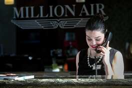 Miriam Garcia prepares for upcoming departures at the Million Air FBO at Hobby Airport Thursday, Jan. 12, 2017, in Houston. ( Jon Shapley / Houston Chronicle )
