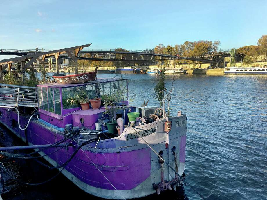 Docked in the 13th arrondissement, the El-Alamein is a houseboat that has been converted into a restaurant and a concert venue. / The Washington Post