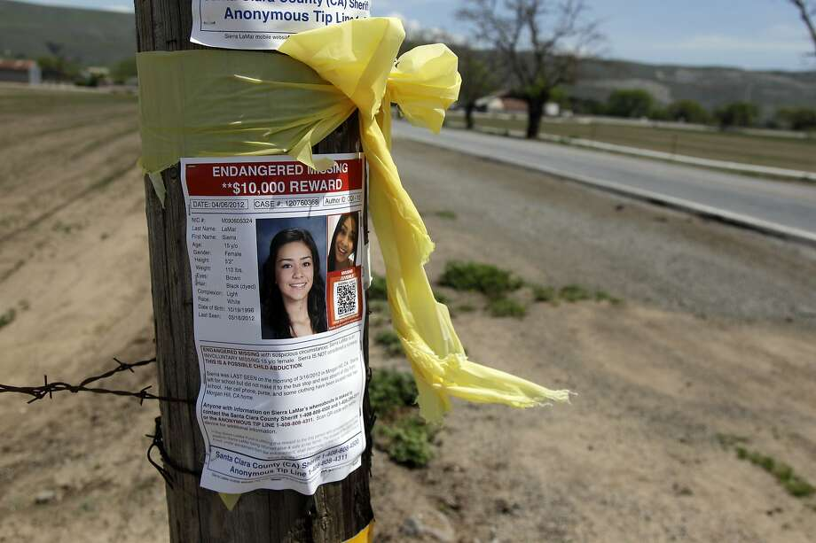 A sign with a photo of missing teen Sierra LaMar is posted at an intersection on Tuesday, April 17, 2012 in Morgan Hill, Calif.  The search for missing 15-year-old Northern California girl expanded on Tuesday as investigators followed new leads one month since her disappearance. The Santa Clara County Sheriff's office would not say what the new leads were in the case of Sierra LaMar, except that they came from evidence already collected. The teen was seen leaving her Morgan Hill home on March 16. (AP Photo/Marcio Jose Sanchez) Photo: Marcio Jose Sanchez, AP