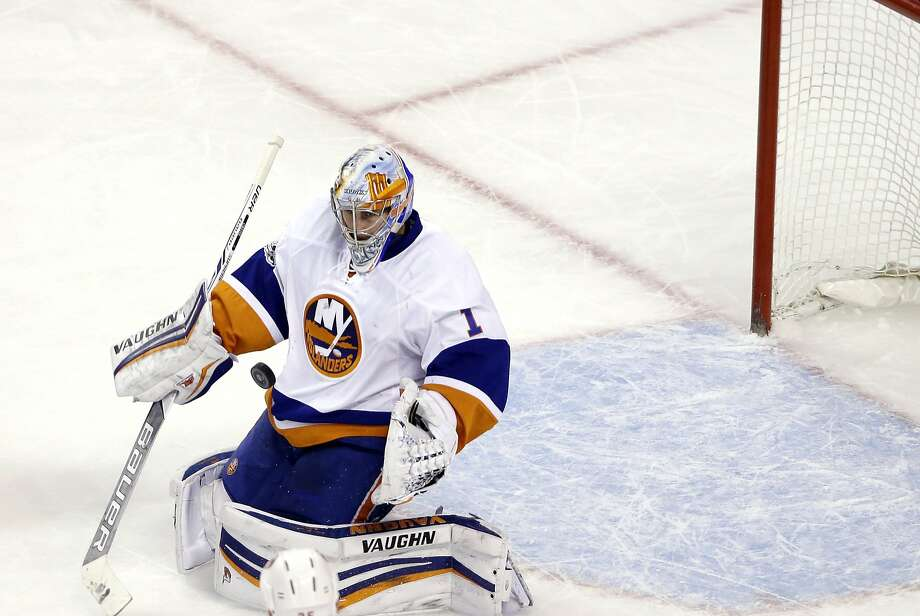 Islanders goalie Thomas Greiss made 32 saves for his first shutout this season in a 4-0 win over Boston. Photo: Elise Amendola, Associated Press