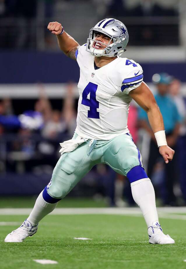 ARLINGTON, TX - JANUARY 15:  Dak Prescott #4 of the Dallas Cowboys celebrates after throwing a touchdown pass during the fourth quarter against the Green Bay Packers in the NFC Divisional Playoff game at AT&T Stadium on January 15, 2017 in Arlington, Texas.  (Photo by Tom Pennington/Getty Images) Photo: Tom Pennington, Getty Images
