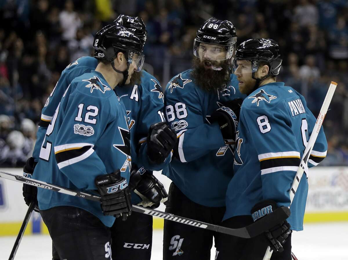 San Jose Sharks' Brent Burns (88) celebrates his goal with teammates Joe Pavelski (8), Patrick Marleau (12) and Joe Thornton, second from left, during the second period of an NHL hockey game against the Winnipeg Jets, Monday, Jan. 16, 2017, in San Jose, Calif. (AP Photo/Marcio Jose Sanchez)