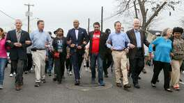 Mayor Ivy Taylor and other local public figures march hand-in-hand in the Martin Luther King Jr. March on Monday, Jan. 16, 2017.  MARVIN PFEIFFER/ mpfeiffer@express-news.net
