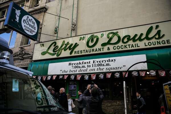 People gather outside Lefty O'Doul's restaurant which will be closing early next month in San Francisco, Calif., on Monday, Jan. 16, 2017.