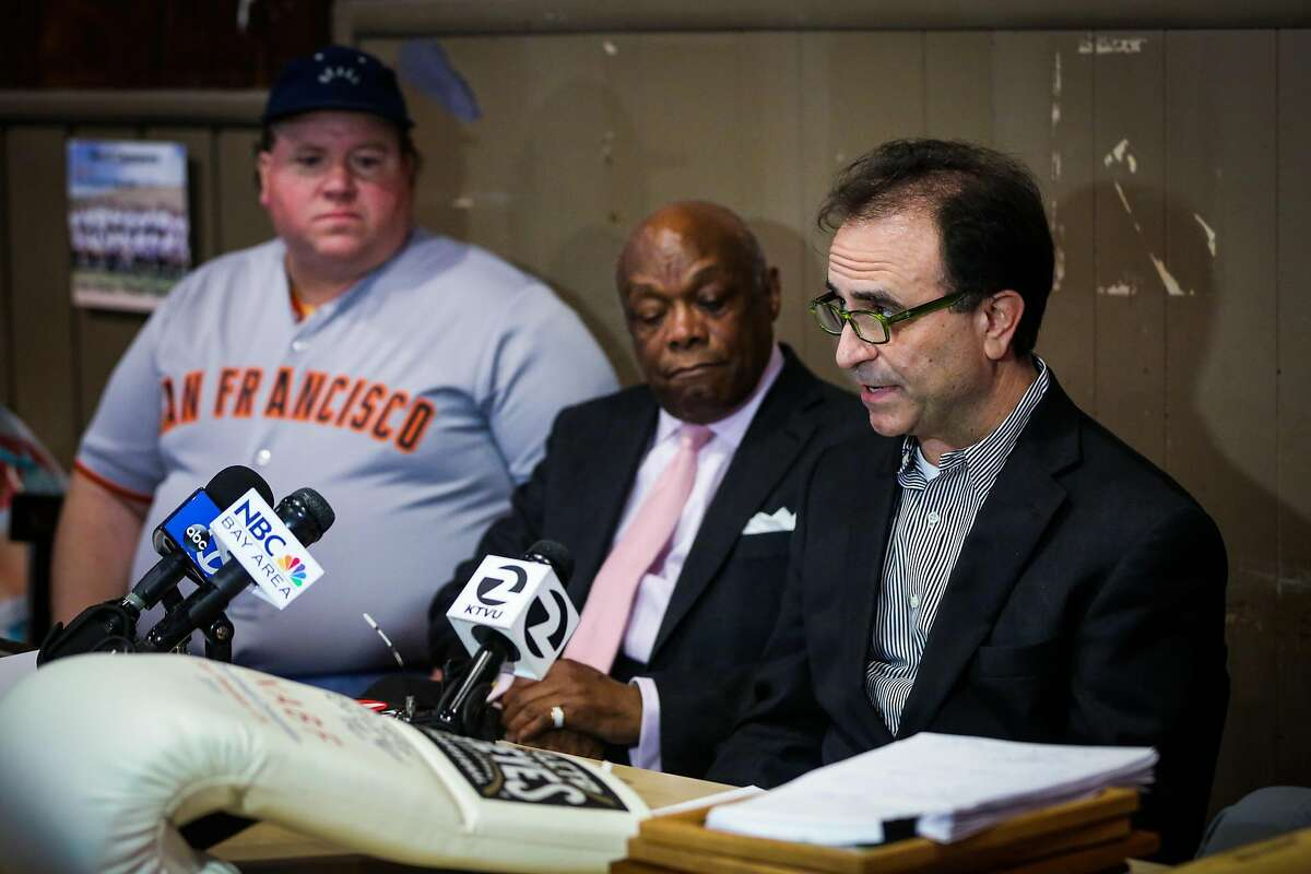 Owner Nick Bovis (right) speaks at a press conference regarding the closing of restaurant Lefty O'Doul's in San Francisco, Calif., on Monday, Jan. 16, 2017.