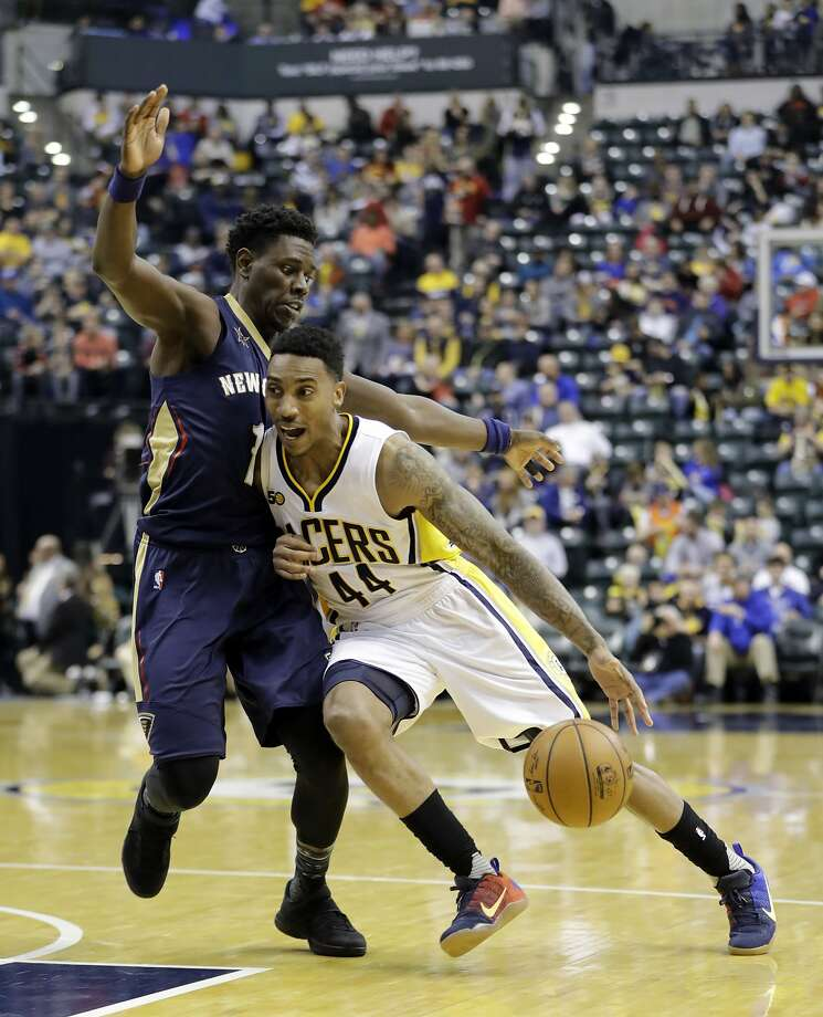 Indiana's Jeff Teague drives on New Orleans' Jrue Holiday during the second half of the Pacers' win. Photo: Darron Cummings, Associated Press
