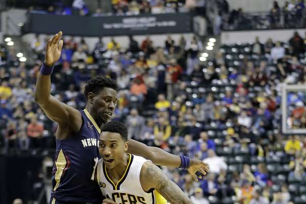 Indiana Pacers' Jeff Teague goes to the basket against New Orleans Pelicans' Jrue Holiday during the second half of an NBA basketball game, Monday, Jan. 16, 2017, in Indianapolis. Indiana defeated New Orleans 98-95. (AP Photo/Darron Cummings)