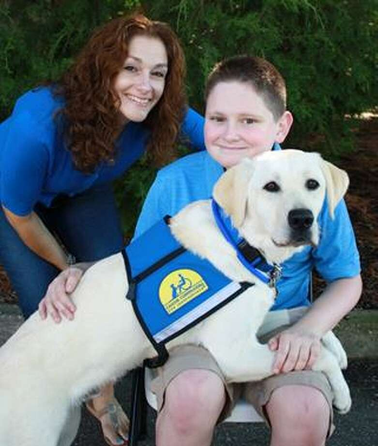 WilL Gibney, 12, of Guilderland, with his mother Laura and new companion, Toshi. (Photo provided)