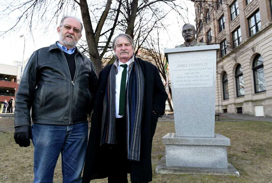 Michael Barrett, left, and Denis Foley, right, stand next to the James Connolly Memorial in Riverfront Park on Monday, Jan. 16, 2017, in Troy, N.Y. The pair are making a documentary film about the famed Irish revolutionary leader who once lived in Troy. Foley is the films' screenwriter and director with Barrett working as historical consultant. (Will Waldron/Times Union) Photo: Will Waldron / 20039430A