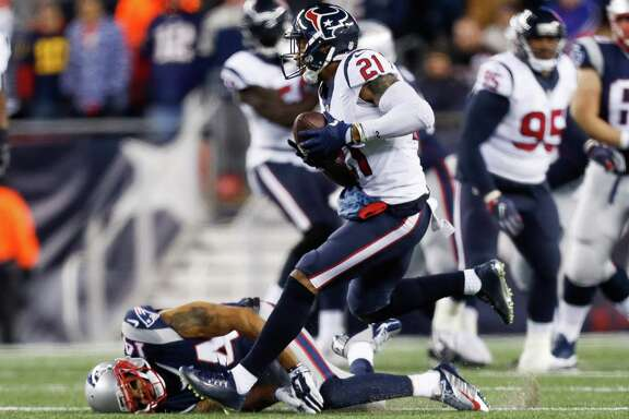 A.J. Bouye moves past the Patriots' Michael Floyd on an interception return in the Texans' loss Saturday night.