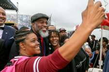 Activist and performing artist David Banner poses for a selfie with fans following his keynote speech in the commemorative program at Pittman-Sullivan Park during the Martin Luther King Jr. March on Monday, Jan. 16, 2017.  MARVIN PFEIFFER/ mpfeiffer@express-news.net