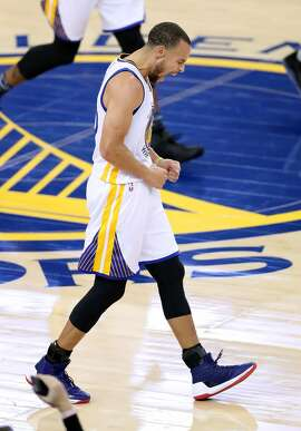 Golden State Warriors' Stephen Curry celebrates a 1st quarter 3-pointer against Cleveland Cavaliers during NBA game at Oracle Arena in Oakland, Calif., on Monday, January 16, 2017.