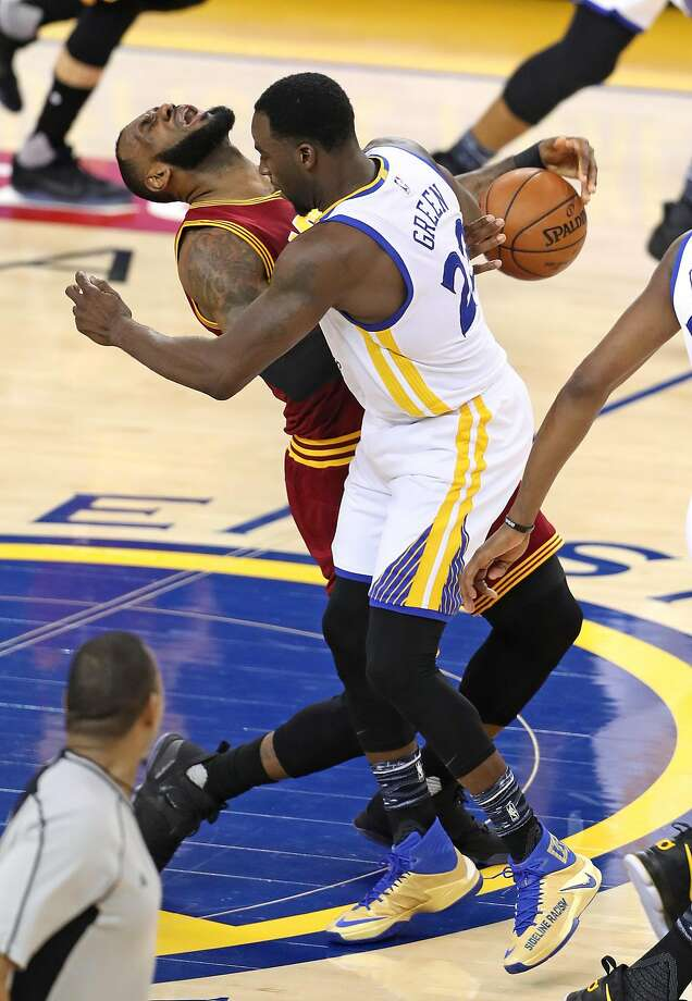 Golden State Warriors' Draymond Green commits a flagrant foul on Cleveland Cavaliers' LeBron James in 2nd quarter during NBA game at Oracle Arena in Oakland, Calif., on Monday, January 16, 2017. Photo: Scott Strazzante, The Chronicle