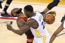 Golden State Warriors' Draymond Green commits a flagrant foul on Cleveland Cavaliers' LeBron James in 2nd quarter during NBA game at Oracle Arena in Oakland, Calif., on Monday, January 16, 2017.