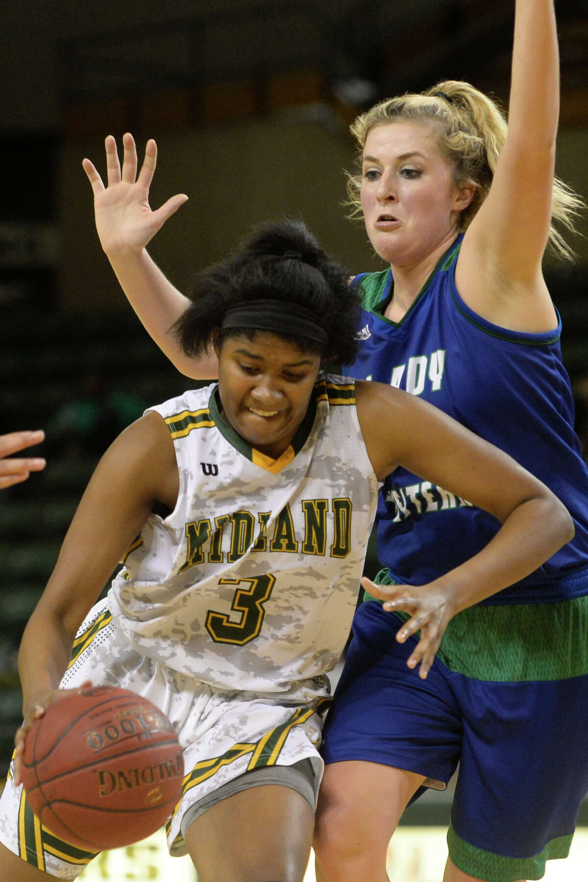 Midland College's Tichina Coleman (3) moves the ball against Western Texas College's McKenna Spikes (44) on Monday, Jan. 16, 2017, at Chaparral Center. James Durbin/Reporter-Telegram