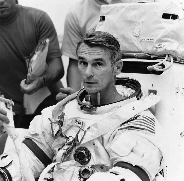 """Apollo 11's Neil Armstrong, left, and Gene Cernan, right, listen to the other member of the Apollo 11 crew """"Buzz"""" Aldrin tell out-of-this world stories at Kennedy Space Center in 1999."""
