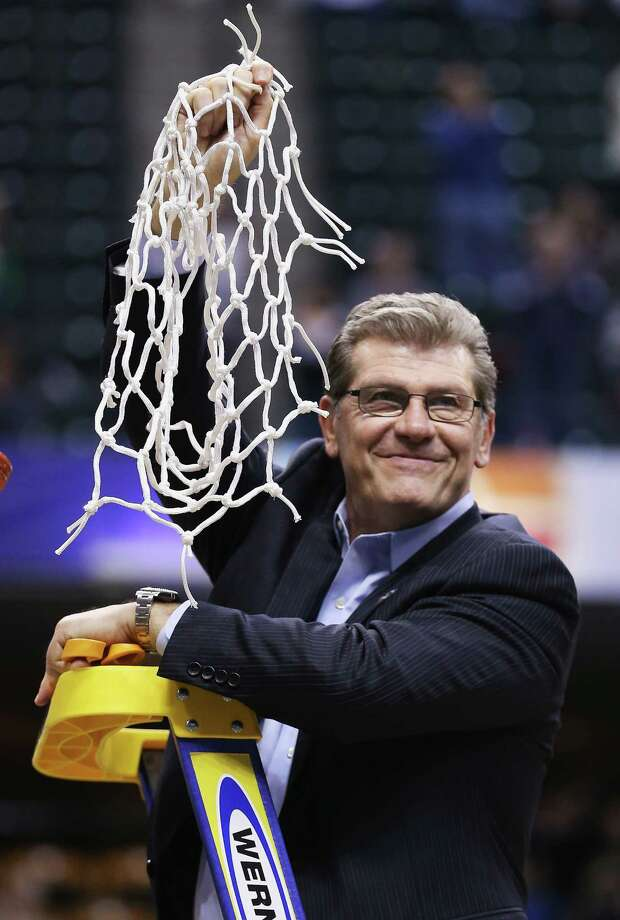 INDIANAPOLIS, IN - APRIL 05:  Head coach Geno Auriemma of the Connecticut Huskies holds up the net after cutting it down following their 82-51 victory over the Syracuse Orange to win the 2016 NCAA Women's Final Four Basketball Championship at Bankers Life Fieldhouse on April 5, 2016 in Indianapolis, Indiana.  (Photo by Andy Lyons/Getty Images) *** BESTPIX *** ORG XMIT: 598514269 Photo: Andy Lyons / 2016 Getty Images
