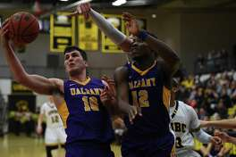 Mike Rowley, left, and Devonte Campbell corral a rebound for UAlbany against UMBC on Monday, Jan. 16, 2017. (Brian Gonzalez / Special to the Times Union)