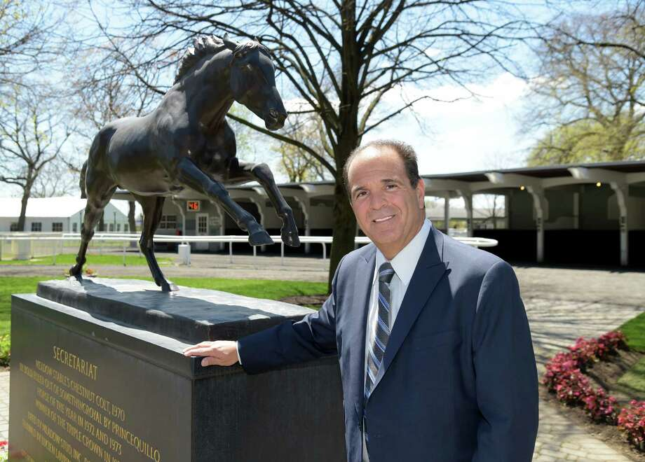 New York Racing Association, Chairman Anthony Bonomo stands in the paddock area of Belmont Park April 29. 2015, in Elmont, N.Y. Behind him is a statue of Secretariat the thoroughbred who won a triple crown at Belmont in 1973. (Newsday / Audrey C. Tiernan) Photo: Audrey C. Tiernan / Newsday