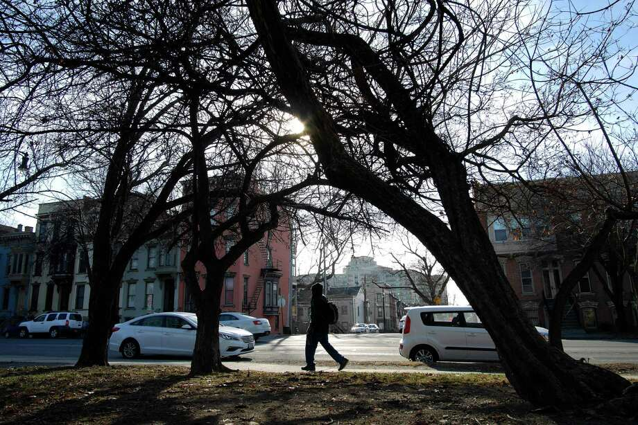 The sun shines through trees along Madison Ave. on Monday, Jan. 16, 2017, in Albany, N.Y.     (Paul Buckowski / Times Union) Photo: STAFF / 20039453A