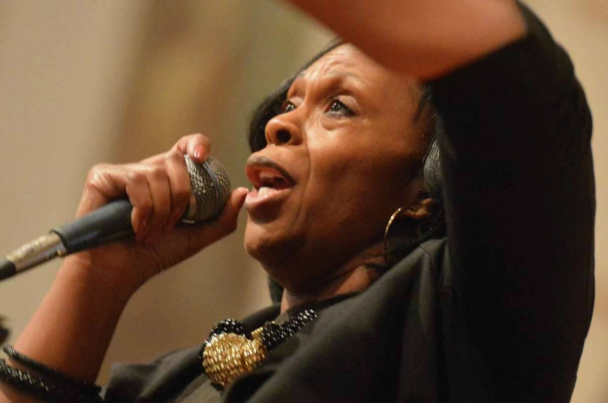 Jackie Bartell sings 'Your Amazing' with the Martin Luther King Choir of Norwalk during the city-wide memorial observance of the national holiday honoring Rev. Dr. Martin Luther King Jr. on Monday January 16, 2017 at Norwalk City Hall in Norwalk Conn.