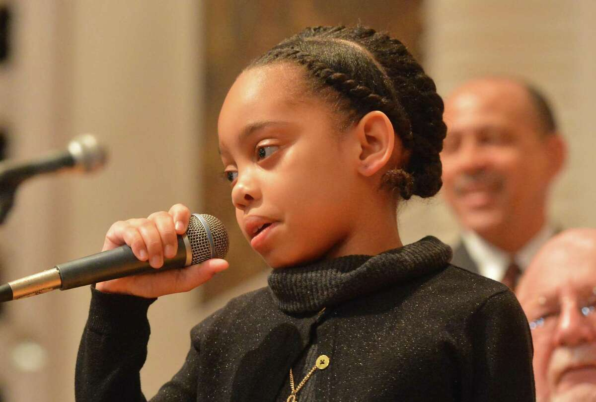9yr old Kiara Copeland welcomes those gathered for during the city-wide memorial observance of the national holiday honoring Rev. Dr. Martin Luther King Jr. on Monday January 16, 2017 at Norwalk City Hall in Norwalk Conn.