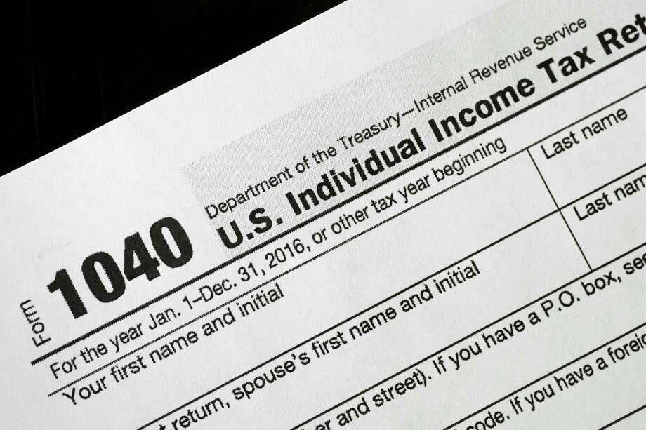 The IRS can be reached at 800-829-1040 Monday-Friday from 6 a.m. to 6 p.m. Central time. Photo: Mark Lennihan, STF / Copyright 2017 The Associated Press. All rights reserved.