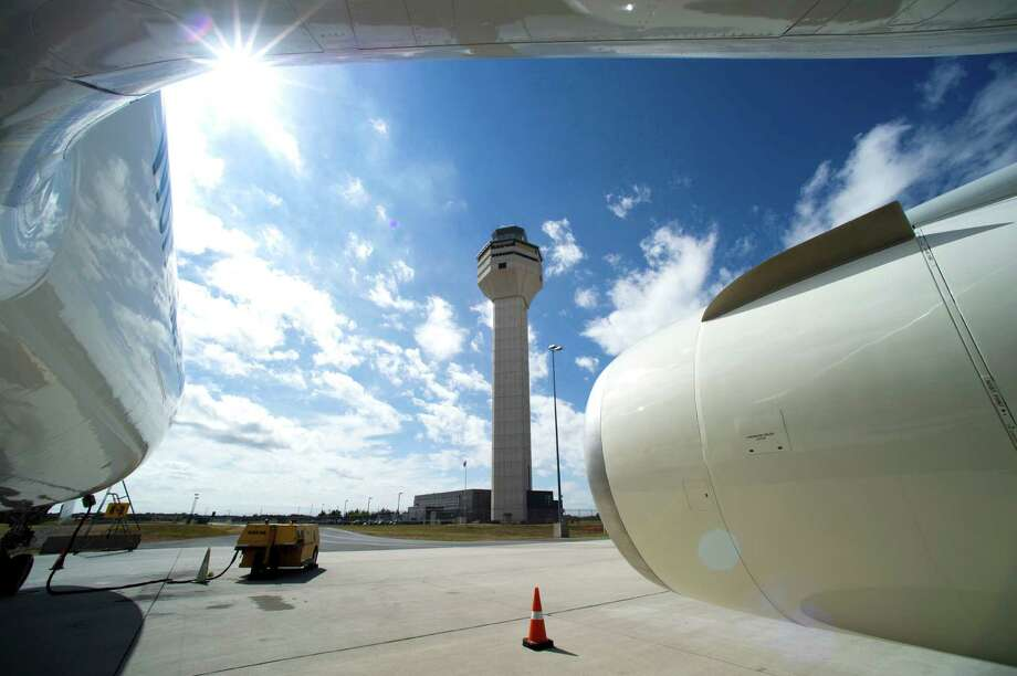 The Dulles International Airport air traffic control tower is seen from a Boeing 777 in Sterling, Va. A watchdog report questions the Federal Aviation Administration's plans for major air traffic control outages. Photo: Cliff Owen, FRE / Cliff Owen