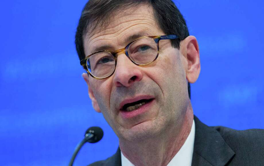 """FILE - In this Tuesday, Oct. 4, 2016, file photo, International Monetary Fund Economic Counsellor Maurice Obstfeld speaks at a news conference during the World Bank/IMF Annual Meetings, at IMF headquarters in Washington. The IMF announced Monday, Jan. 16, 2017, it is raising its forecast for the U.S. economy in 2017 and in 2018, reflecting an expected boost from the economic policies of President-elect Donald Trump. """"The global economic landscape started to shift in the second half of 2016,"""" Obstfeld said, helped by a rebound in manufacturing activity in many countries and the financial market rally that started with Trump's November election victory. (AP Photo/Jose Luis Magana, File) Photo: Jose Luis Magana, FRE / FR159526 AP"""