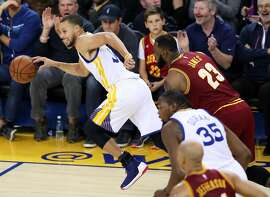 Golden State Warriors' Stephen Curry heads up court after stealing ball from Cleveland Cavaliers' Lebron James in 2nd quarter during NBA game at Oracle Arena in Oakland, Calif., on Monday, January 16, 2017.