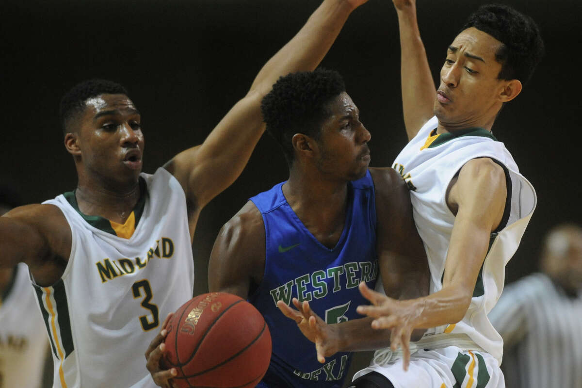 Midland College's Devin Campbell (left) and Juan Cardenas (right) guard Western Texas College's Zarious Moffett (5) on Monday, Jan. 16, 2017, at Chaparral Center. James Durbin/Reporter-Telegram
