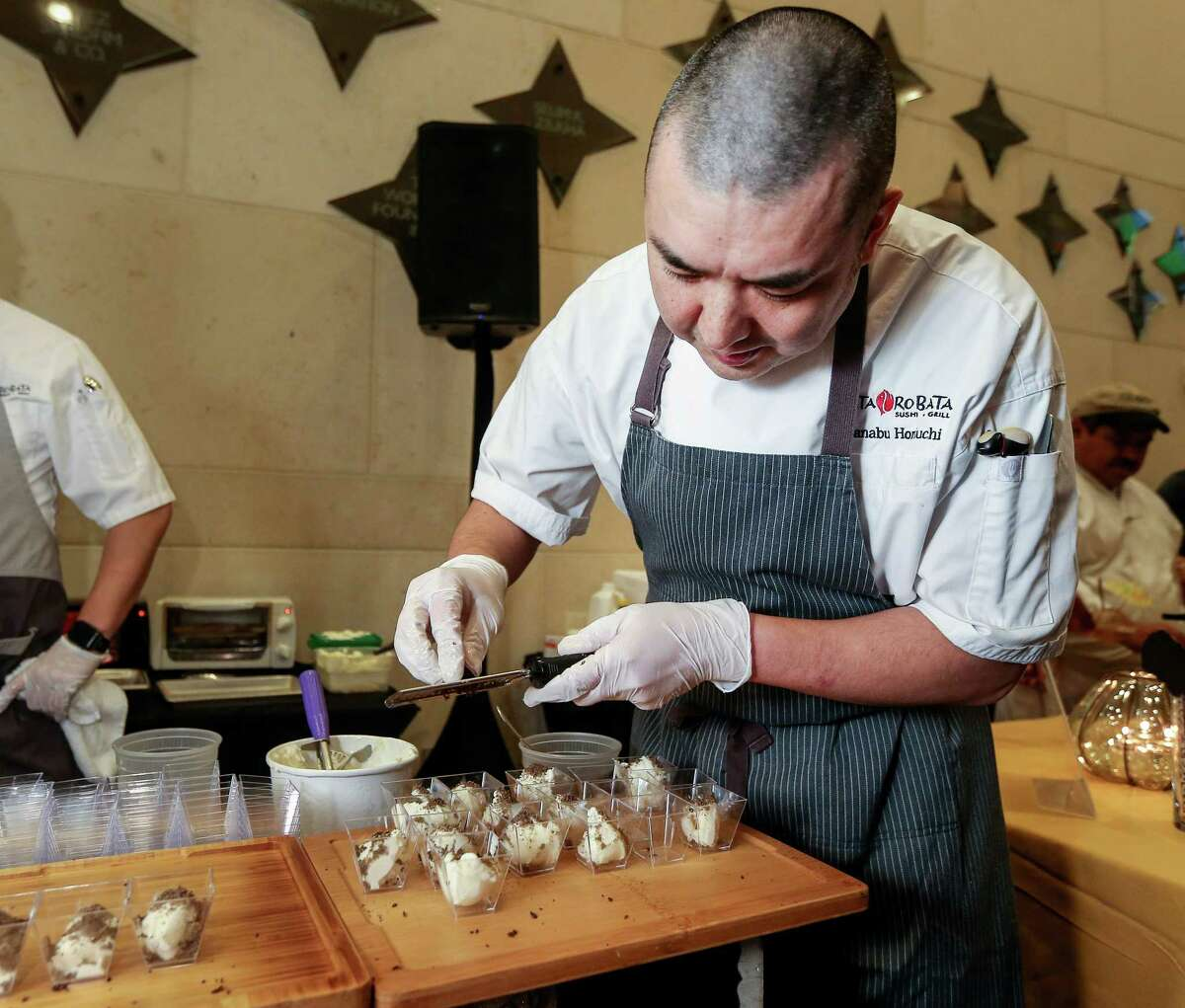 Manabu Horiuchi, the executive chef from Kata Robata, prepares honey truffle ice cream at Truffle Masters 2017, at the Hobby Center. Horiuchi won first place; he also created an open face truffle banh mi sandwich.