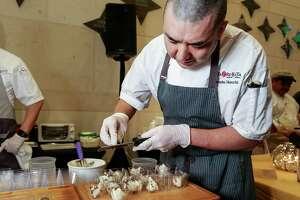 Manabu Horiuchi, the executive chef from Kata Robata, prepares honey truffle ice cream at Truffle Masters 2017, at the Hobby Center, Monday, Jan. 16, 2017, in Houston.