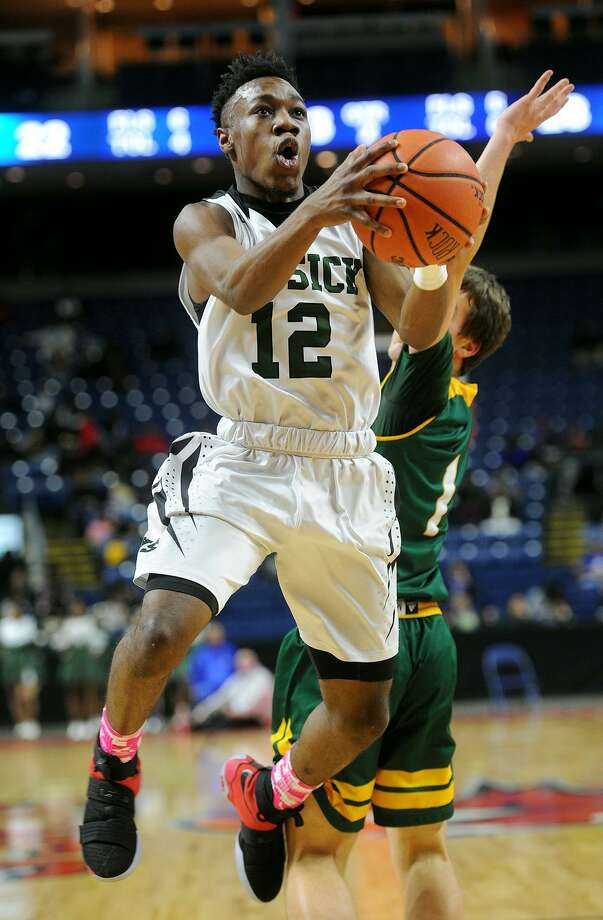 Bassick's Qualon Wilkes drives to the basket during his team's game with Hamden in the third annual MLK Ali Classic at the Webster Bank Arena in Bridgeport on Monday. Photo: Brian A. Pounds / Hearst Connecticut Media / Connecticut Post