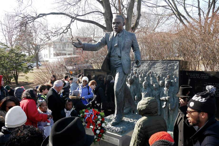 People gather around the Dr. Martin Luther King, Jr. memorial in Lincoln Park following a wreath laying ceremony on Monday, Jan. 16, 2017, in Albany, N.Y.     (Paul Buckowski / Times Union) Photo: PAUL BUCKOWSKI / 20039401A