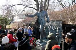 People gather around the Dr. Martin Luther King, Jr. memorial in Lincoln Park following a wreath laying ceremony on Monday, Jan. 16, 2017, in Albany, N.Y.     (Paul Buckowski / Times Union)