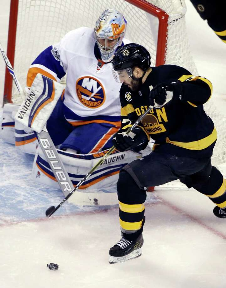 New York Islanders goalie Thomas Greiss (1) defends against Boston Bruins center Patrice Bergeron (37) in the first period of an NHL hockey game, Monday, Jan. 16, 2017, in Boston. (AP Photo/Elise Amendola) ORG XMIT: MAEA102 Photo: Elise Amendola / Copyright 2017 The Associated Press. All rights reserved.