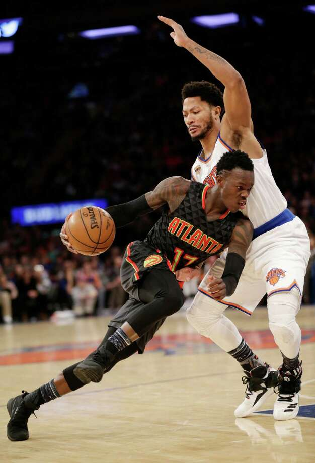 Atlanta Hawks' Dennis Schroder, left, pushes past New York Knicks' Derrick Rose during the second half of the NBA basketball game, Monday, Jan. 16, 2017 in New York. The Hawks defeated the Knicks 108-107. (AP Photo/Seth Wenig) ORG XMIT: NYSW109 Photo: Seth Wenig / Copyright 2017 The Associated Press. All rights reserved.