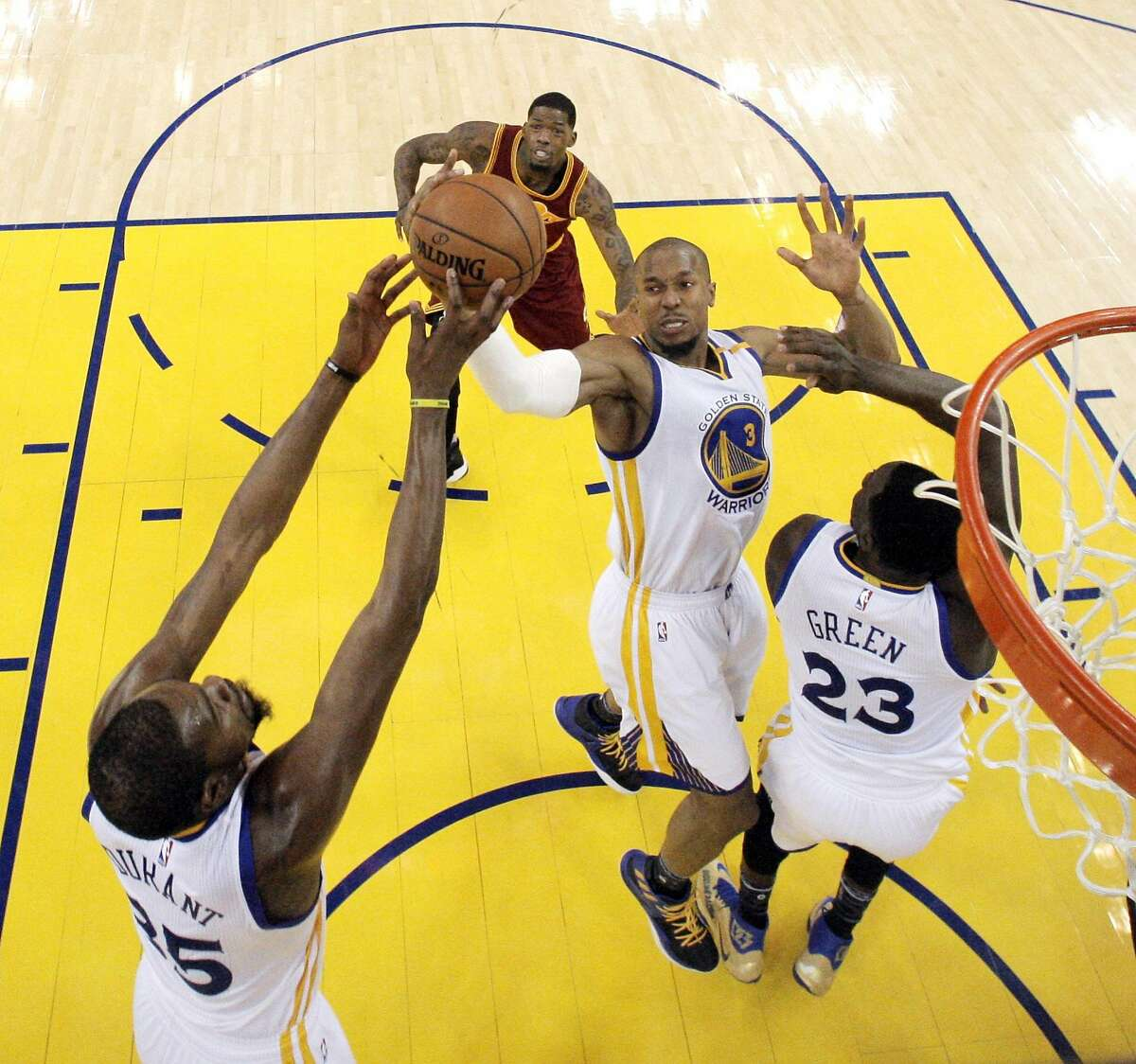 David West (3) reaches for a rebound in the second half as the Golden State Warriors played the Cleveland Cavaliers at Oracle Arena in Oakland, Calif., on Monday, January 16, 2017.