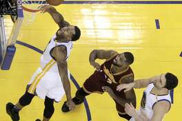 Andre Iguodala (9) reaches for a rebound in the second half as the Golden State Warriors played the Cleveland Cavaliers at Oracle Arena in Oakland, Calif., on Monday, January 16, 2017.