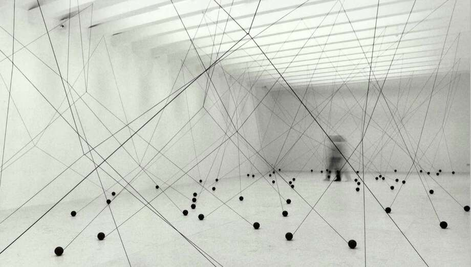 """Magdalena Fernandez's installation """"2i000.17"""" fills Sicardi Gallery's large downstairs room with a maze created by elastic cords. Photo: Sicardi Gallery"""
