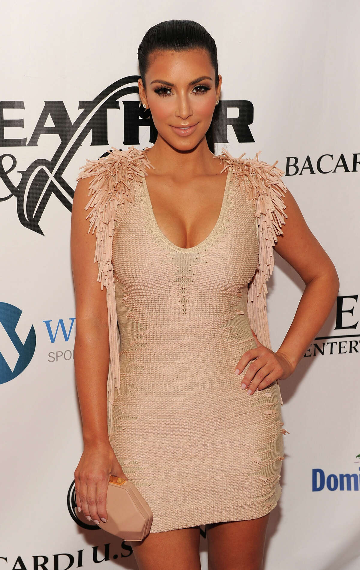 TV personality Kim Kardashian attends the Leather & Laces Super Bowl Party presented by Dominican Republic Ministry of Tourism at the Paris Theater on February 5, 2010 in Miami Beach, Florida. (Photo by Dimitrios Kambouris/Getty Images for Leather & Laces)